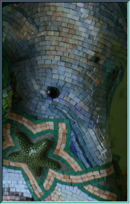 Breaking stones, mosaics, glass, wood briquettes, glazed ceramic, aquamarine, rock crystal, ceiling tiles, mosaic dolphin